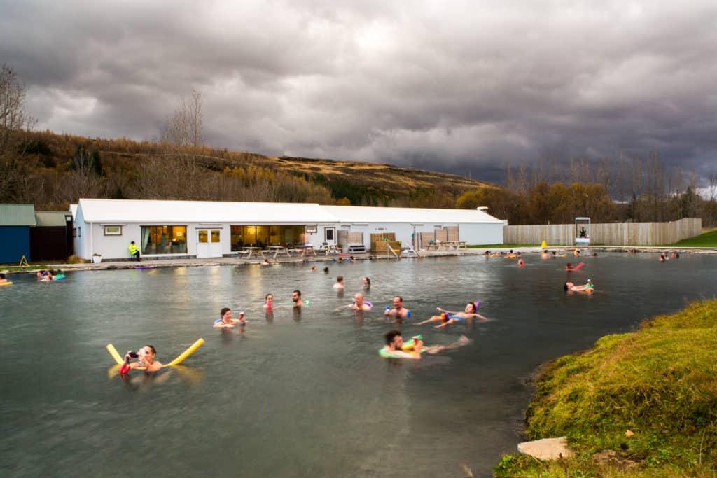 People swimming in Fludir's hot springs in Iceland