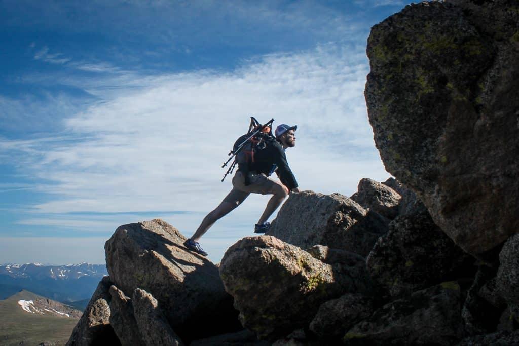 man hiking and climbing